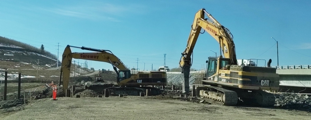 Excavation between the piles to remove the debris and earth