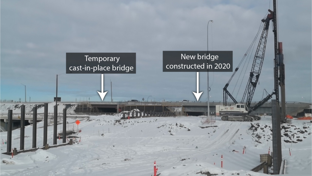 Looking north between two sets of piles; the Trans-Canada Highway detour can be seen in the background