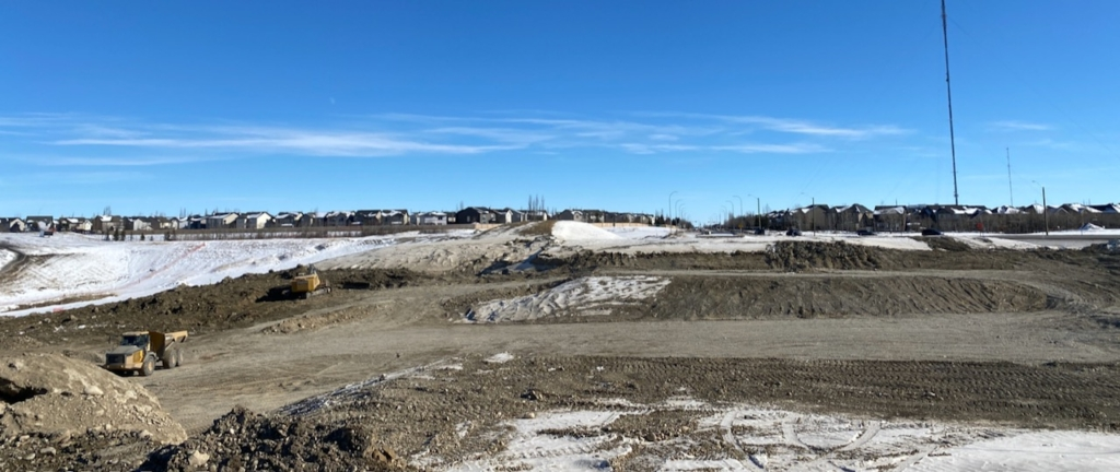 Looking east at excavation in the Old Banff Coach Road S.W. right-of-way