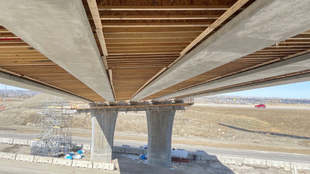 Deck joists are visible underneath the bridge