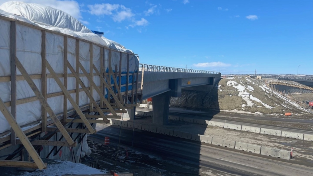 Looking north at the new bridge over the Trans-Canada Highway with the retaining wall and bridge pictured above on the right of the photo
