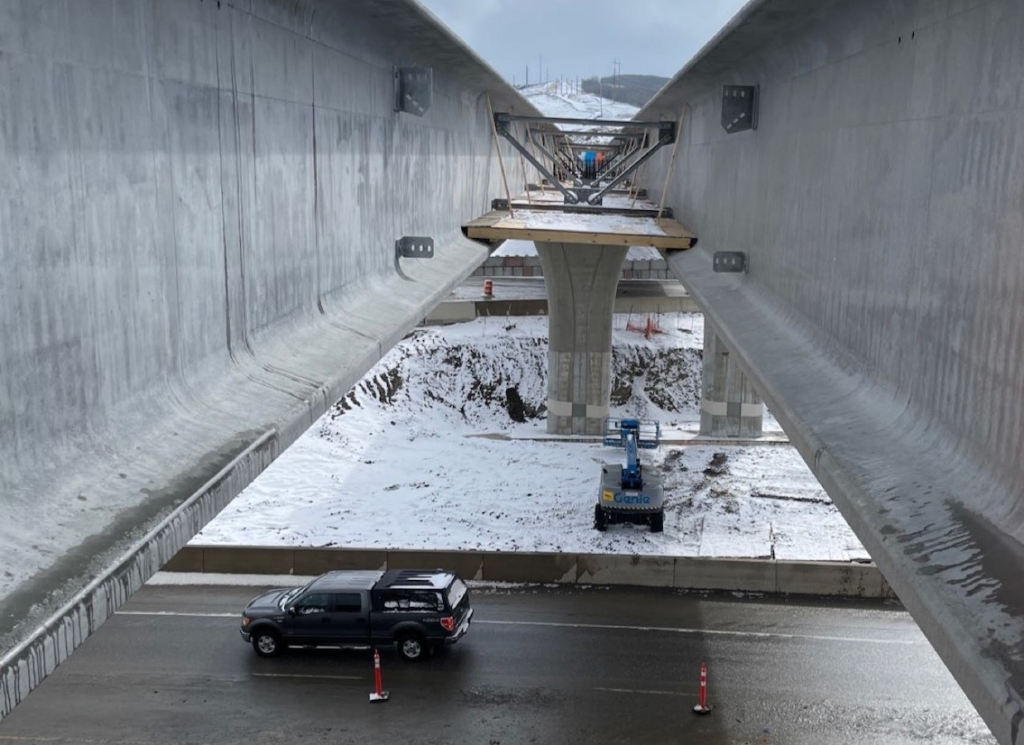 Looking south in between the girders; the ramp lanes from southbound Stoney Trail to eastbound Trans-Canada Highway are underneath