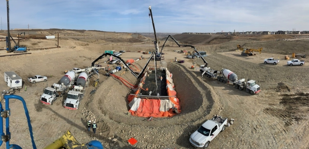 Looking north at the concrete pour; the Paskapoo Slope is visible in the background