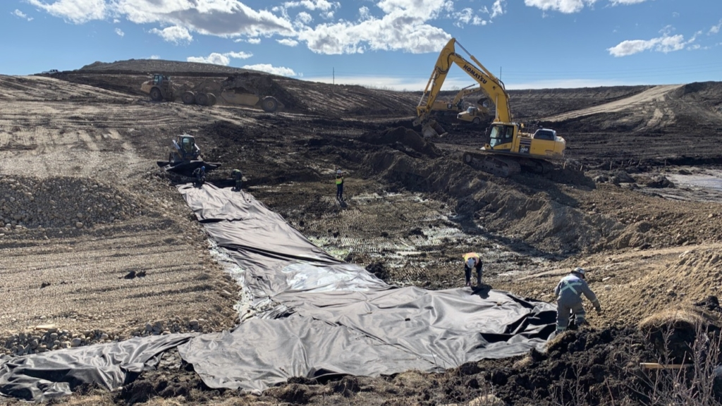 Placing geotextile fabric for the drainage culvert